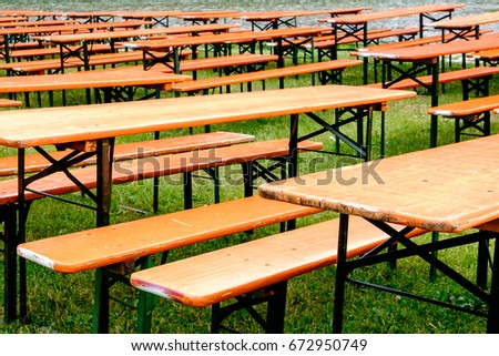 bavarian beergarden - table and benches at a river
