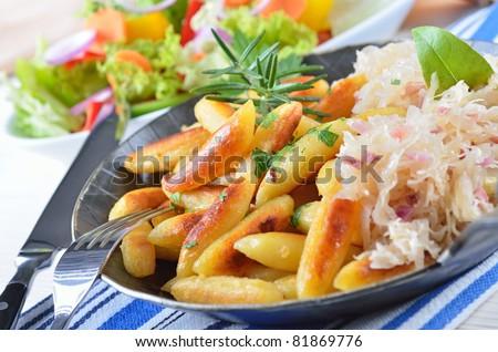 Bavarian finger-shaped potato dumpling / potato noodles - stock photo