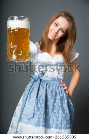 Bavarian girl with beer - stock photo