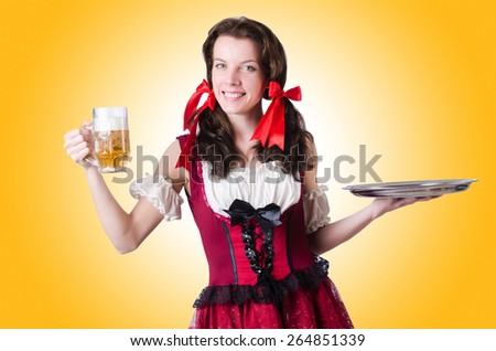 Bavarian girl with tray on white - stock photo
