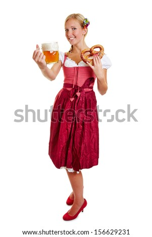 Bavarian happy woman smiling with mug of beer and a pretzel