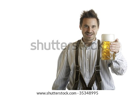 Bavarian Man dressed with traditional leather trousers (lederhose) holding Oktoberfest Beer Stein (Mass)