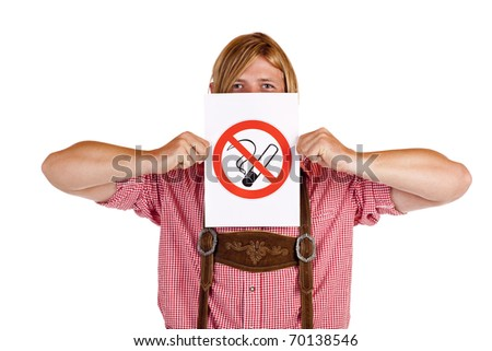 Bavarian man in lederhose holds no-smoking-rule sign in front of face. Isolated on white background. - stock photo