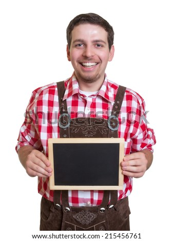 Bavarian man with leather pants and chalk board - stock photo