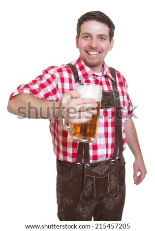 Bavarian man with leather pants showing beer mug - stock photo