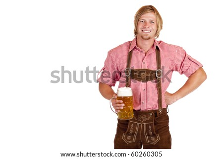 Bavarian man with leather trousers (lederhose) holds oktoberfest beer stein in hand. Isolated on white background.