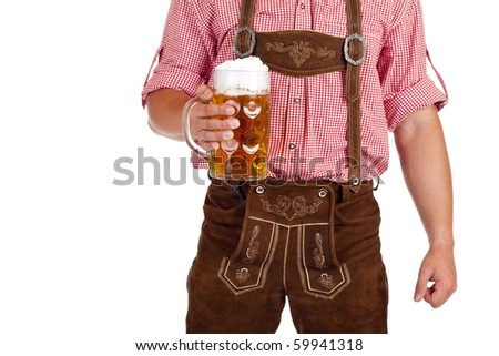 Bavarian man with leather trousers (Lederhose) holds Oktoberfest beer stein. Isolated on white background. - stock photo