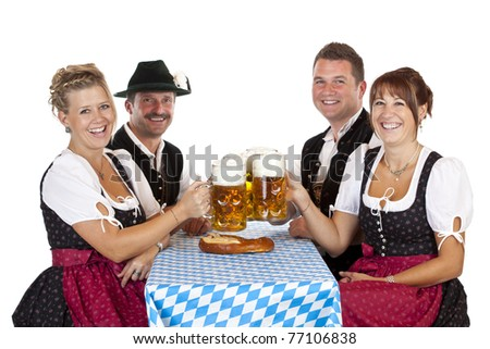 Bavarian men and girls toast with Oktoberfest beer stein. Isolated on white background. - stock photo