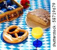 bavarian picnic cloth with basket and food on it - stock photo