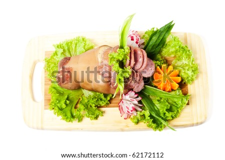 Bavarian roasted knuckle of pork with vegetables on white background