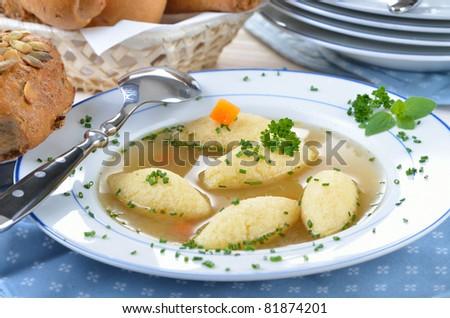 Bavarian semolina dumpling soup - stock photo