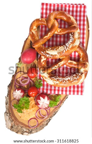 Bavarian vegetarian breakfast with two soft pretzels and cheese delicacy from Germany isolated on white - stock photo