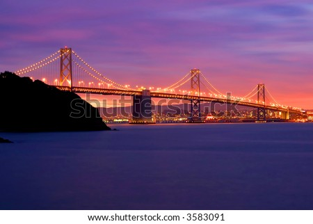 Bay Bridge after sunset in San Francisco - stock photo