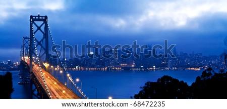bay bridge and san francisco at night panoramic view - stock photo
