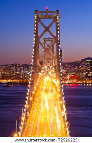 Bay Bridge at sunset and twilight time, San Francisco, United States of America - stock photo