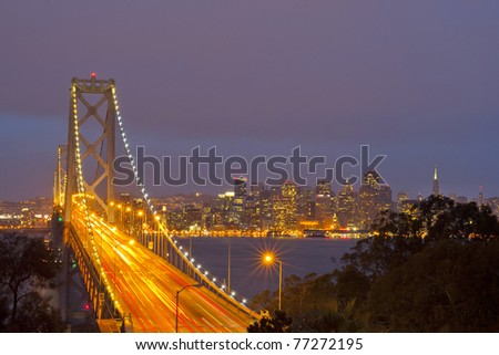 Bay Bridge at twilight with ocean in the foreground. San Francisco, USA - stock photo