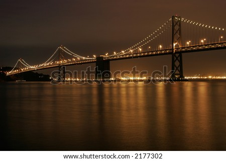 Bay Bridge Illuminated at night, San Francisco, CA - stock photo