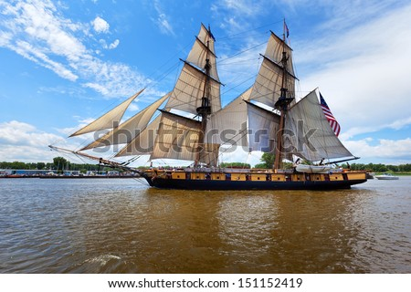 BAY CITY, MICHIGAN-JULY 11, 2013: Tall Ship Niagara in full sail as it makes its way from Saginaw Bay into the Saginaw River for the Tall Ship Celebration - stock photo