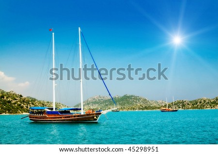 Bay in mediterranean sea with old yacht and fun sun in the Kekova. Turkey. - stock photo