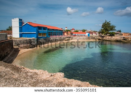 Bay in old colonial cuban city of Gibara, with old port buildings - stock photo