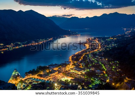 Bay of Kotor night panorama with historical Kotor old town, and the Boka-Kotorska bay rocky shores. Montenegro.