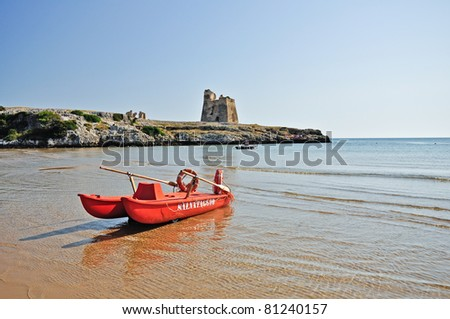 Bay of Sfinale, near Peschici, with an ancient Torre Saracena, typical lookout tower of the coast of Gargano. - stock photo
