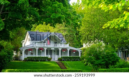 BAY VIEW, MI - JUNE 26, 2014: A quaint old home serves as a bed and breakfast in this one-time Methodist retreat center lying on the shores of Lake Michigan next door to the resort town of Petoskey. - stock photo
