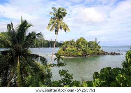 Bay with island and palm trees on the coast in Upolu, Samoa - stock photo