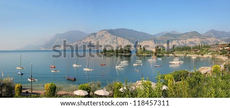 bay with sailing boats, nearby malcesine, garda lake - stock photo