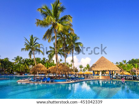 BAYAHIBE, DOMINICAN REPUBLIC, June 11, 2016: Swimming pool in tropical hotel Be Live Canoa.