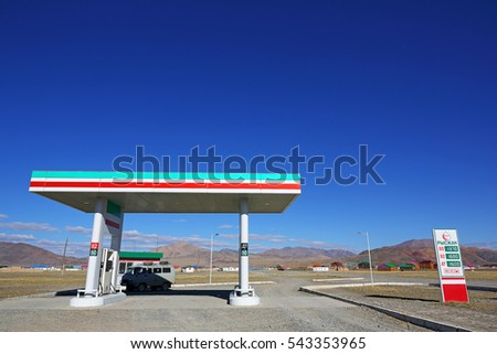 BAYAN-ULGII, MONGOLIA - SEP 25: Risjan, fuel at the gas station with road steppe and blue sky of Western Mongolia on September 25, 2016 in Bayan-Ulgii, Mongolia