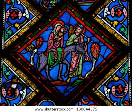 BAYEUX - FEBRUARY 12: Stained glass window depicting  the Holy Family in Bethlehem, in the cathedral of Bayeux, Normandy, France on February 12, 2013. - stock photo