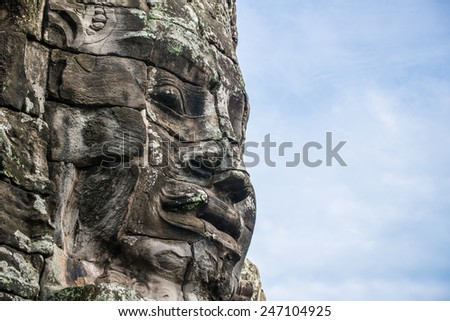 Bayon face of ancient Khmer kingdom, Cambodia. - stock photo