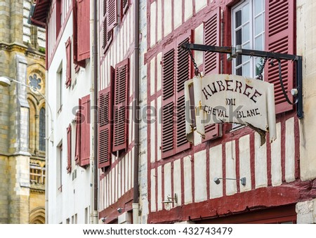 Bayonne, France - May 21, 2016: Hostel signboard in a facade of typical building of Aquitaine. Bayonne, France. - stock photo