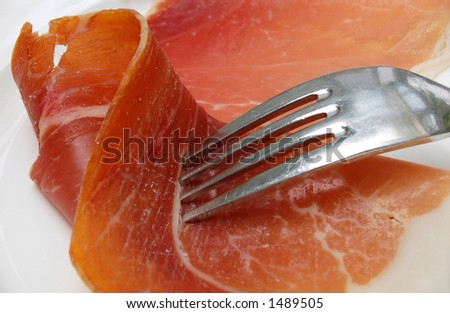 Bayonne Ham (south western french ham) with fork on plate - stock photo