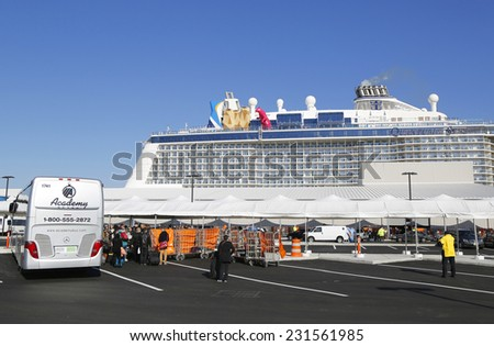 BAYONNE, NEW JERSEY - NOVEMBER 18: First passengers arriving at Newest Royal Caribbean Cruise Ship Quantum of the Seas docked at Cape Liberty Cruise Port before inaugural voyage on November 18, 2014 - stock photo