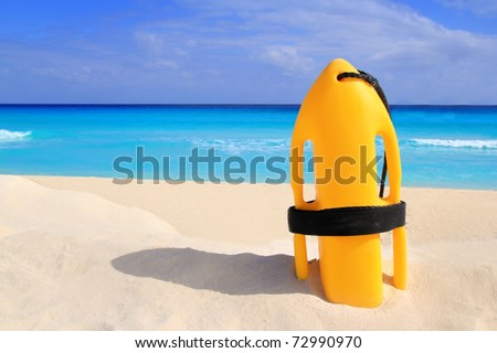 Baywatch rescue buoy yellow on tropical beach Caribbean sea