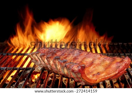 BBQ Baby Back Spicy Marinated And Smoked Pork Ribs On The Hot Charcoal Grill With Bright Flames On Black Background. Good Snack For Outdoor Party Or Picnic - stock photo