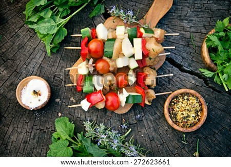 BBQ barbecue ingredients. Marinated BBQ meat. Marinated grill chicken and kebab. Vegetables and meat for barbecue - stock photo