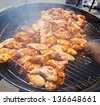 BBQ chicken wings cooking on a hot grill - stock photo