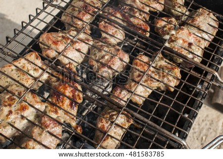 BBQ cooked on the grate of the grill