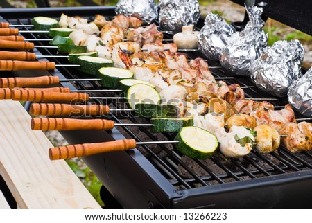 BBQ cooking. Sticks on a grate. - stock photo