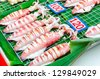 bbq grilled squids on skewers at the market - stock photo