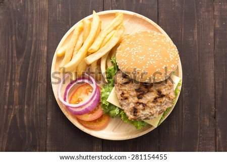 BBQ hamburgers with french fries on wooden background - stock photo