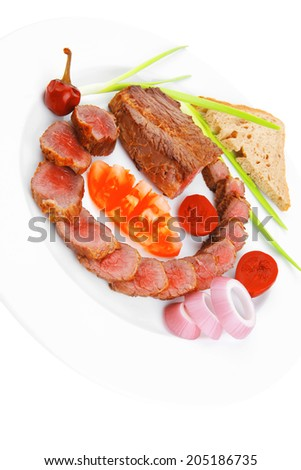 Bbq meat served on white plate with tomatoes , sprouts and bread isolated on white background