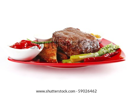 bbq meat with spices on red dish