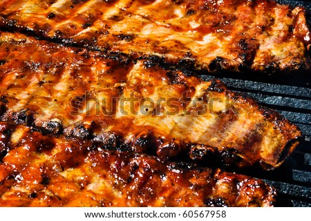 BBQ Pork Ribs on the Grill - stock photo