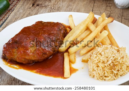 BBQ Pork ribs red sauce and French Fried - stock photo