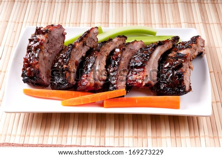bbq pork ribs with a rich barbeque sauce - stock photo