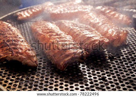 BBQ ribs grilled meat smoke fog barbecue food - stock photo